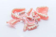 Group of dentures on white background Royalty Free Stock Photography