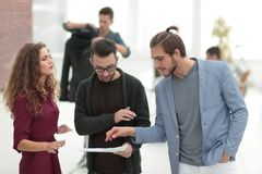 Group of designers discussing new proposals Stock Photography