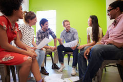 Group Of Designers Meeting To Discuss New Ideas Royalty Free Stock Image