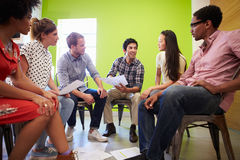 Group Of Designers Meeting To Discuss New Ideas Stock Photography