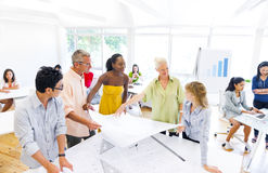 Group of Designers Planning for a New Project Stock Photos