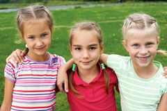 Group of different children having good summertime Royalty Free Stock Photo