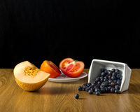 Group of different fruit and vegetables. Melon, blueberry, tomato Royalty Free Stock Image