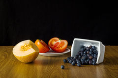 Group of different fruit and vegetables. Melon, blueberry, tomato Royalty Free Stock Photo