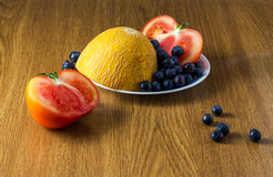 Group of different fruit and vegetables. Melon, blueberry, tomato Stock Photography