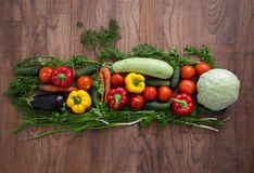 Group of different fruit and vegetables. On a wooden background Stock Photo