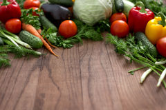 Group of different fruit and vegetables. On a wooden background Stock Image