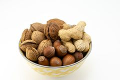 Group of different nuts in a bowl on white background stock photography