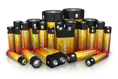Group of different size batteries. Isolated on white reflective background Stock Photos