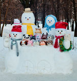 Group of different size dressed snowmen outdoors in winter Stock Photos