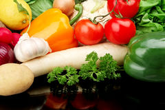 Group of different vegetables on black Stock Photography