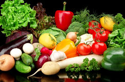 Group of different vegetables on black background Royalty Free Stock Images