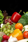 Group of different vegetables and fruits on black royalty free stock photography