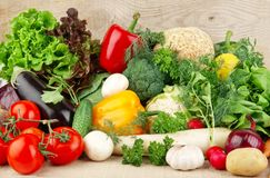 Group of different vegetables on wooden board stock photography