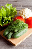 Group of different vegetables on wooden plank Stock Photography