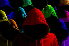 Group of differently colored hooded hackers cybersecurity concept royalty free stock image