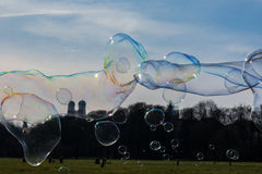 Group of Differently Sized Bubbles Floating Top of Munich Landscape Royalty Free Stock Photos