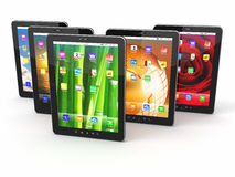 Group of digital tablet pc with different screen backgrounds Stock Image