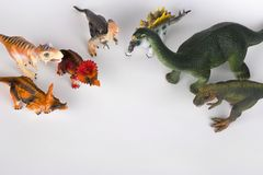Group of dinosaurus plastic toy model. S isolated on white background stock photography