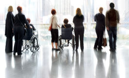 Group and disabled people in the lobby business center Royalty Free Stock Image