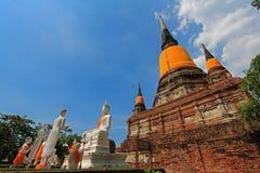 A group of 5 disciples / monks at Wat Yai Chai Mongkol in Ayutthaya Stock Photos