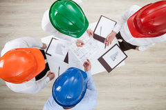 Group discussion in a construction company Stock Photography