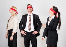 Group of disoriented businesspeople. With red ribbons on eyes Royalty Free Stock Photo