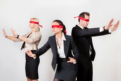 Group of disoriented businesspeople. With red ribbons on eyes Royalty Free Stock Photography