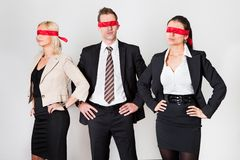 Group of disoriented businesspeople. With red ribbons on eyes Stock Photos