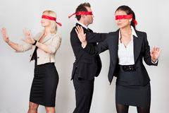 Group of disoriented businesspeople. With red ribbons on eyes Stock Images