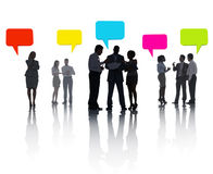 Group of Diverse Business People Sharing Ideas with Colorful Speech Bubble Royalty Free Stock Photos