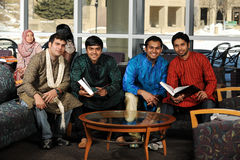 Group of Diverse College Students. Wearing their traditional attire in the University Campus Stock Photography