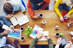 Group of diverse designers having a discussion. About and ideas stock photo