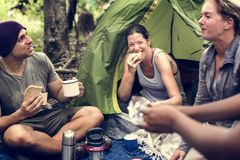 Group of diverse friends camping in the forest royalty free stock photos