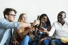 Group of diverse friends drinking beers together Royalty Free Stock Photos