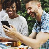 Group of diverse friends enjoying summer party together Stock Images