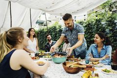 Group of diverse friends enjoying summer party together stock photos