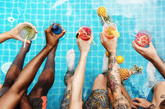 Group of diverse friends enjoying summer time with beverage Stock Photography