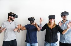 Group of diverse friends experiencing virtual reality. With VR headset royalty free stock photos