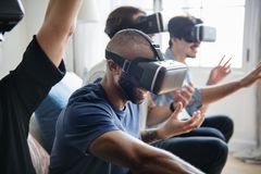 Group of diverse friends experiencing virtual reality with VR hea. Dset stock photos