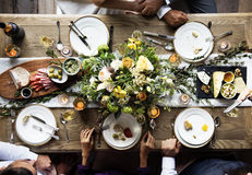 Group of Diverse Friends Gathering Having Food Together royalty free stock image