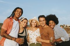 Group of diverse friends hanging out at the beach stock images