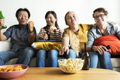 Group of diverse friends having a movie night drinking beer Stock Photography