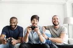 Group of diverse friends having vdo competition game Stock Photo