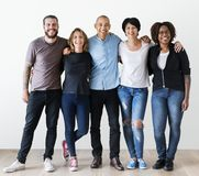 Group of diverse friends hugging Stock Images