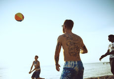Group of diverse friends playing beach ball together Royalty Free Stock Photo