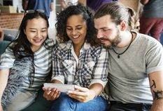 Group of diverse friends playing game on mobile phone royalty free stock photo