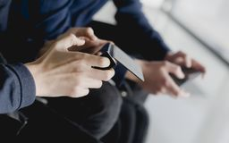 Group of diverse friends playing game on mobile phone stock photography