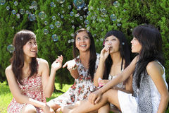 Group of diverse friends playing with soap buble Royalty Free Stock Images