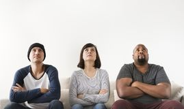 Group of diverse friends sitting on couch Royalty Free Stock Image